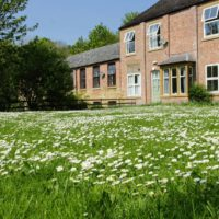 large grass garden area in front of Cote Ghyll Mill