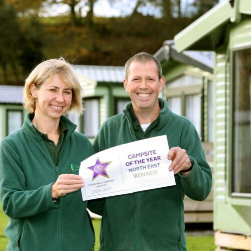 Helen & Jon Hill holding a 'Campsite of the Year' award