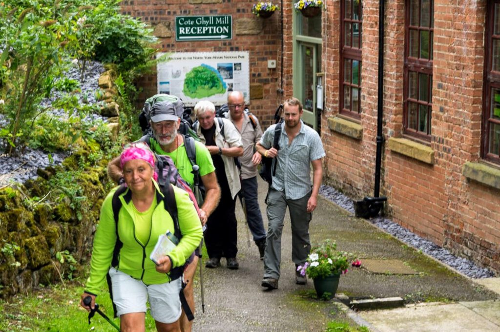 group of walkers exiting Cote Ghyll Mill