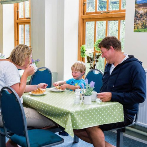family eating breakfast in dining room