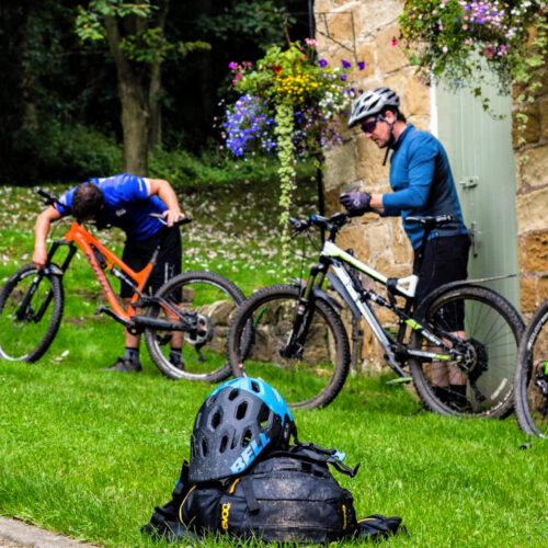 cyclists preparing their bikes at Cote Ghyll MIll