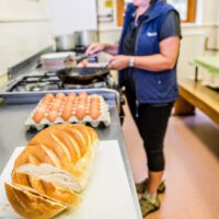 woman preparing food in kitchen at Cote Ghyll Mill