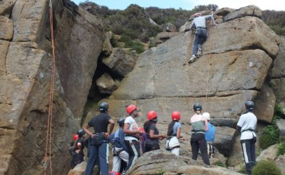 Group of teenagers rock climbing