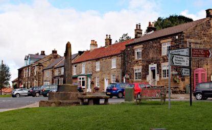 Village centre of Osmotherley with stone monument