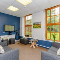 large tv lounge at Cote Ghyll Mill