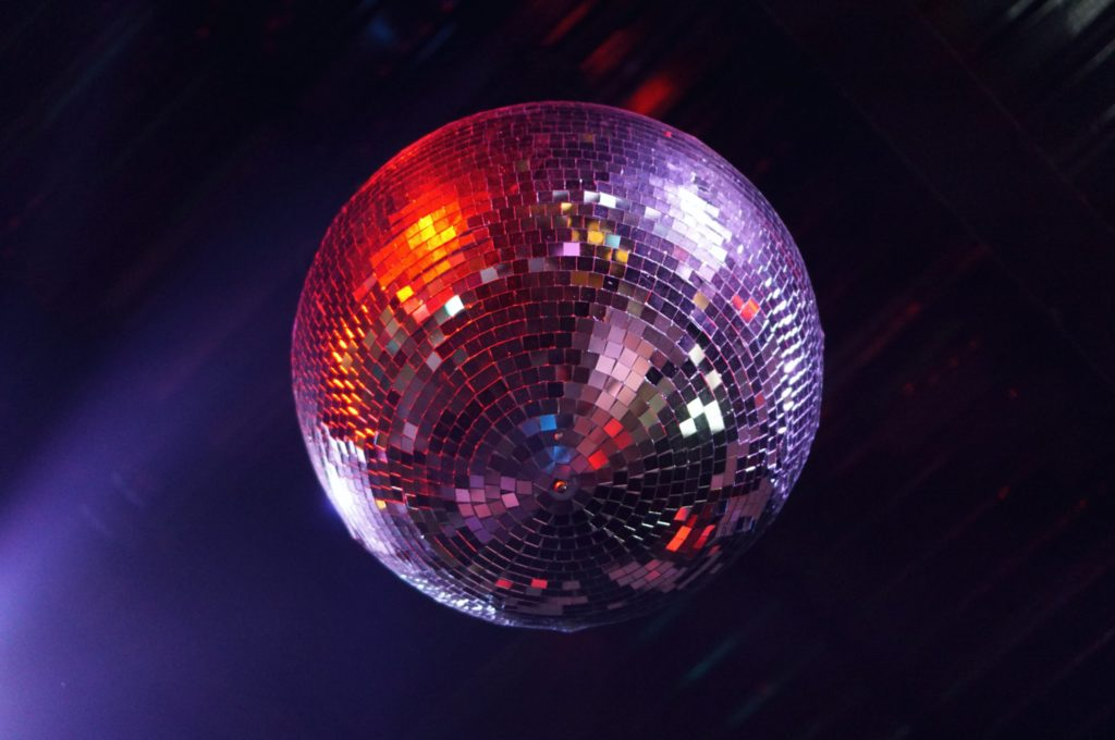 Glittering disco ball hanging from ceiling