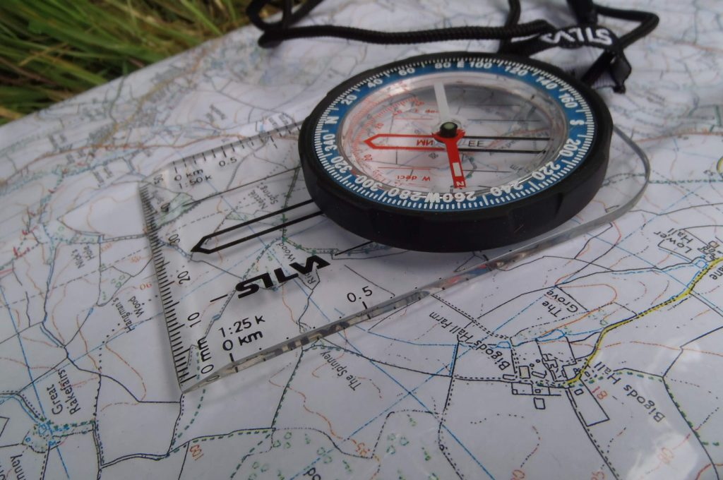 A compass resting on a map